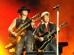 Why have only one neck on your guitar when you can have two? Jon Bon Jovi and Richie Sambora Source: By Marjovi73 (Own work) [CC BY-SA 3.0 (http://creativecommons.org/licenses/by-sa/3.0)], via Wikimedia Commons