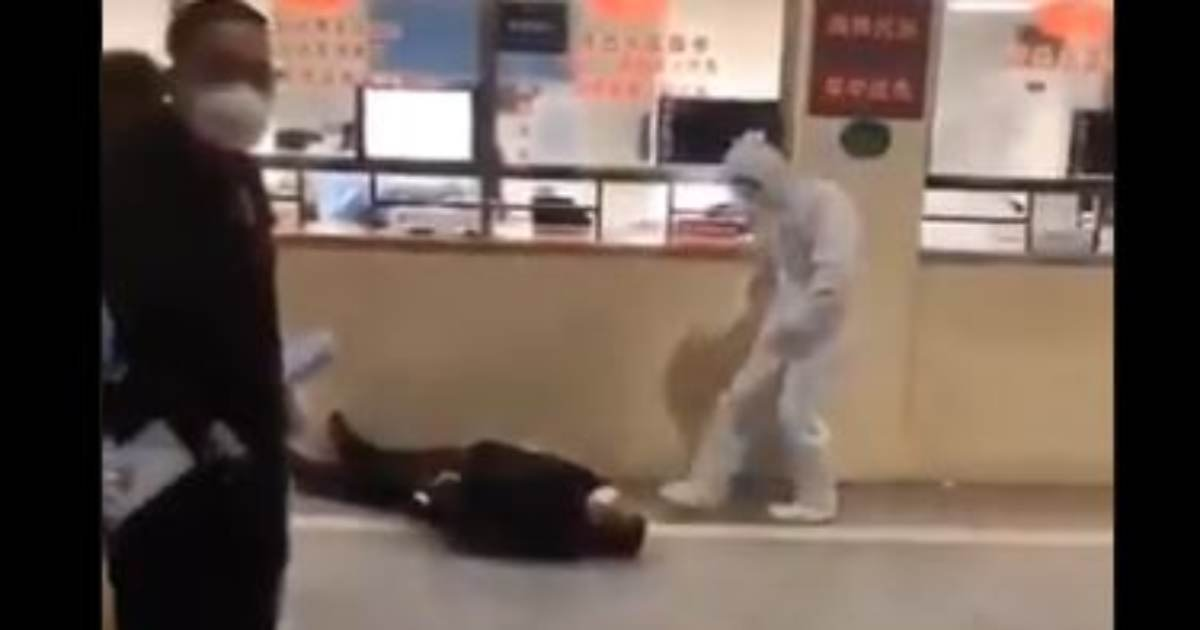 Wuhan Coronavirus outbreak dead body with men in quarantine suits.